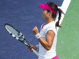 Li Na celebrates victory over Dominnika Cibulkova during the quarter final match during the BNP Paribas Open on March 13, 2014