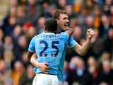 Edin Dzeko of Manchester City celerates with teammate Fernandinho after scoring his team's second goal during the Barclays Premier league match between Hull City and Manchester City at KC Stadium on March 15, 2014