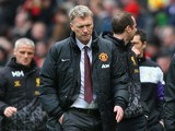 Manchester United Manager David Moyes heads for the dressing room at half-time during the Barclays Premier League match between Manchester United and Liverpool at Old Trafford on March 16, 2014