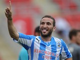 Huddersfield's Martin Paterson celebrates after scoring against Rotherham during a friendly match on July 20, 2013
