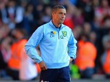 A dejected Chris Hughton manager of Norwich City looks on during the Barclays Premier League match between Southampton and Norwich City at St Mary's Stadium on March 15, 2014