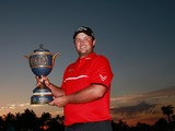 Patrick Reed celebrates with the Gene Sarazen Cup after his one-stroke victory during the final round of the World Golf Championships-Cadillac Championship at Trump National Doral on March 9, 2014