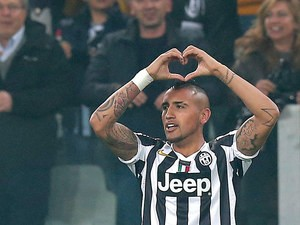 Juventus' Arturo Vidal celebrates after scoring the opening goal against Fiorentina during their Europa League match on March 13, 2014