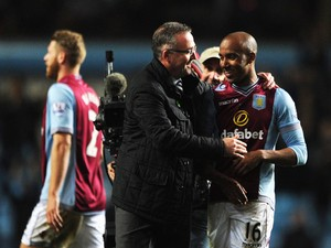 Paul Lambert manager of Aston Villa congratulates goal scorer Fabian Delph of Aston Villa after the Barclays Premier League match between Aston Villa and Chelsea at Villa Park on March 15, 2014