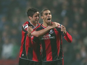 Lewis Grabban of Bournemouth celebrates with a team mate Andrew Surman after scoring the first goal during the Sky Bet Championship match between Blackburn Rovers and Bournemouth at Ewood Park on March 12, 2014