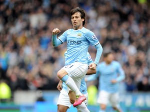 David Silva of Manchester City celebrates after he scores the first goal of the game for his side during the Barclays Premier League match between Hull City and Manchester City at the KC Stadium on March 15, 2014