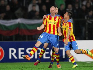Valencia's Philippe Senderos celebrates with teammates after scoring his team's third goal against Ludogorets during their Europa League match on March 13, 2014