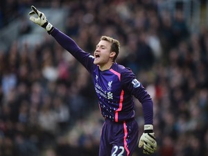 Goalkeeper Simon Mignolet of Liverpool gives instructions during the Barclays Premier League match between Hull City and Liverpool at KC Stadium on December 1, 2013