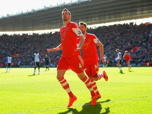 Morgan Schneiderlin of Southampton celebrates scoring the opening goal with Jay Rodriguez of Southampton during the Barclays Premier League match between Southampton and Norwich City at St Mary's Stadium on March 15, 2014