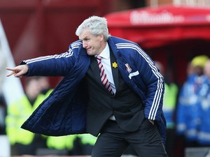 Mark Hughes manager of Stoke City gives instructions during the Barclays Premier League match between Stoke City and West Ham United at Britannia Stadium on March 15, 2014