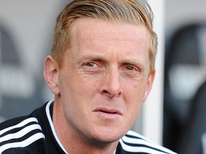 Manager of Swansea City Gary Monk looks on during the Barclays Premier League match between Swansea City and West Bromwich Albion at Liberty Stadium on March 15, 2014