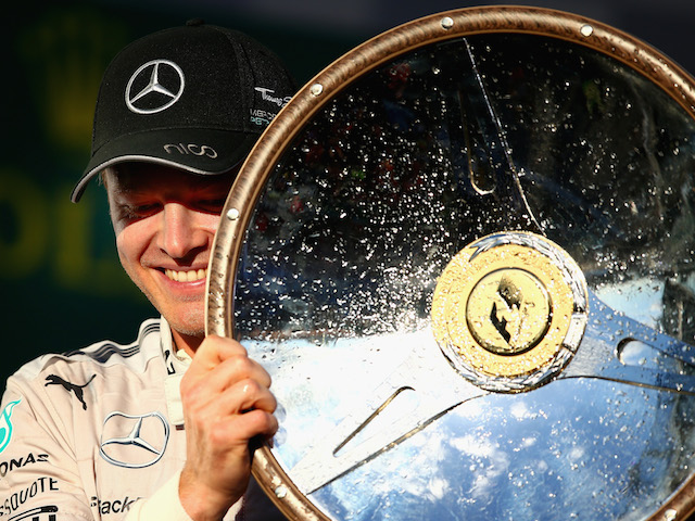 Nico Rosberg of Germany and Mercedes GP celebrates on the podium after winning the Australian Formula One Grand Prix at Albert Park on March 16, 2014