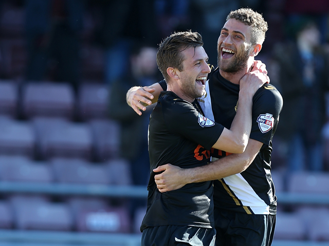 Doug Loft of Port Vale celebrates with team mate Ben Williamson #19 after scoring his sides 1st goal during the Sky Bet League One match between Coventry City and Port Vale at Sixfields on March 16, 2014