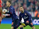 Arsenal midfielder Aaron Ramsey celebrates with teammate Santi Cazorla during the Champions League game against Bayern Munich on March 13, 2013