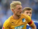 Hoffenheim's defender Andreas Beck (L) vies for the ball during the German first division Bundesliga football match against FC Schalke 04 on March 8, 2014
