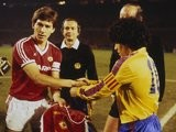 Bryan Robson shakes hands with Diego Maradona before Manchester United face Barcelona on March 21, 1984.