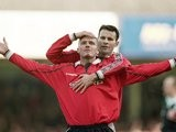 Ryan Giggs and David Beckham celebrate the latter's goal for Manchester United against Leicester City on March 18, 2000.