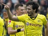 Dortmund's defender Mats Hummels (R) celebrates with his teammates after scoring during the German first division Bundesliga football match against Hannover 96 on March 22, 2014