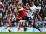 Rickie Lambert of Southampton tries to get past Tottenham Hotspur's Younes Kaboul during their Premier League match on March 23, 2014
