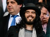 Comic actor Russell Brand enjoys the atmosphere during the nPower Championship Playoff Semi Final 2nd Leg between West Ham United and Cardiff City at the Boleyn Ground on May 7, 2012