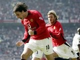 Ruud van Nistelrooy, then of Manchester United, celebrates scoring against Fulham on March 22, 2003.