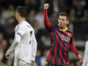 Barcelona'sLionel Messi celebrates after scoring his team's second goal against Real Madrid in the La Liga match on March 23, 2014