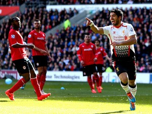 Luis Suarez of Liverpool scores a goal to level the scores at 1-1 during the Barclays Premier League match against Cardiff City on March 22, 2014
