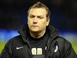 Barnsley caretaker coach Micky Mellon during the Sky Bet Championship match between Brighton & Hove Albion and Barnsley at The Amex Stadium on December 03, 2013