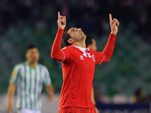 Sevilla's forward Jose Antonio Reyes celebrates after scoring during the UEFA Europa League Round of 16 football match Real Betis Balompie vs Sevilla FC at the Benito Villamarin stadium in Sevilla on March 20, 2014