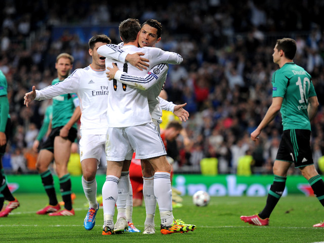 Cristiano Ronaldo of Real Madrid celebrates with teammate Gareth Bale after scoring the opening goal during the UEFA Champions League Round of 16 second leg match against Schalke on March 18, 2014