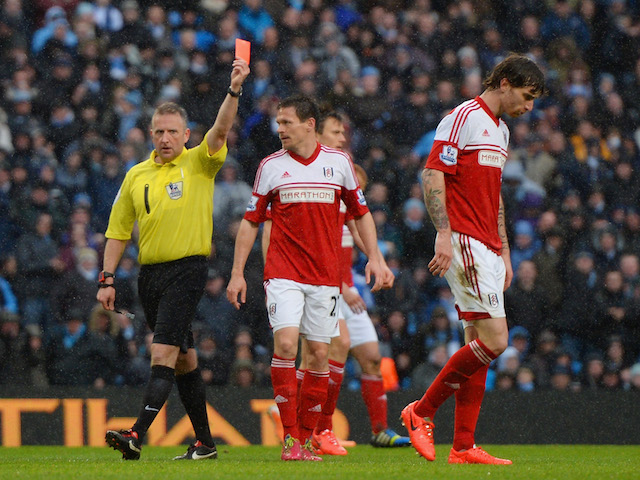 Referee Jonathan Moss shows Fernando Amorebieta of Fulham a red card during the Barclays Premier League match against Manchester City on March 22, 2014