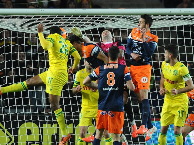 Nantes' French defender Koffi Djidji (L) scores a goal during the French L1 football match between Nantes and Montpellier on March 22, 2014