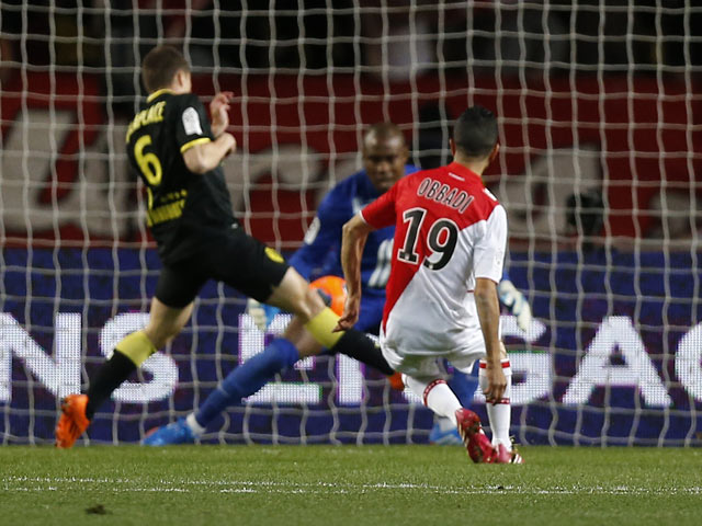Monaco's Mounir Obbadi scores the opening goal against Lille in the Ligue 1 match on March 23, 2014