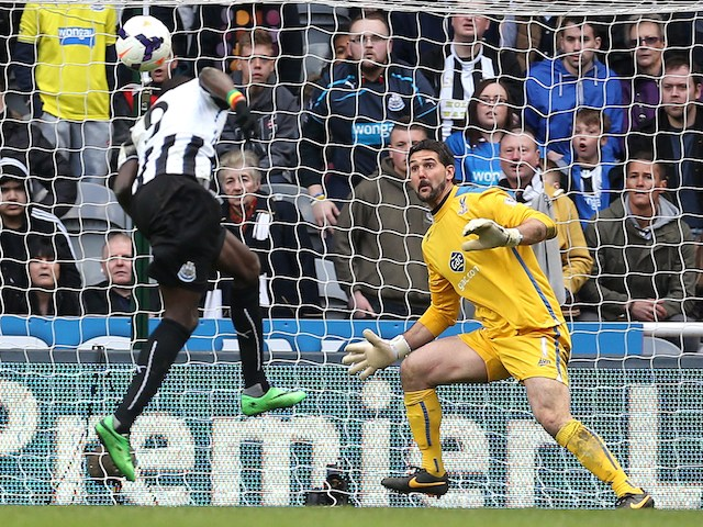 Newcastle United's Senegalese striker Papis Cisse scores a final minute winner during the English Premier League football match against Crystal Palace on March 22, 2014
