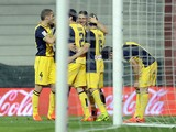 Atletico Madrid's players celebrate their second goal during the Spanish league football match Athletic Club Bilbao vs Atletico Madrid at the San Mames stadium in Bilbao on March 29, 2014