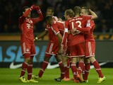 Bayern Munich's French midfielder Franck Ribery celebrates scoring with his teammates during the German first division Bundesliga football match Hertha BSC Berlin vs FC Bayern Munich in Berlin's Olympic Stadium on March 25, 2014