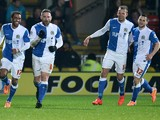 David Dunn of Blackburn Rovers celebrates scoring the 2nd goal with team-mates during the Sky Bet Championship match between Watford and Blackburn Rovers at Vicarage Road on March 25, 2014