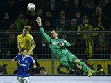 Dortmund's striker Marco Reus vies for the ball with Schalke's midfielder Max Meyer and Schalke's goalkeeper Ralf Fahrmann during the German first division Bundesliga football match Borussia Dortmund vs FC Schalke 04 in Dortmund, western Germany, on March