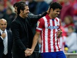 Head coach Diego Simeone of Atletico de Madrid congratulates goal-scorer Diego Costa during a La Liga match on October 27, 2013
