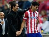 Head coach Diego Simeone of Atletico de Madrid congratulates goal-scorer Diego Costa during a La Liga match on October 27, 2013