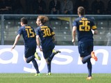 Marco Donadel #30 of Hellas Verona celebrates after scoring his openig goal during the Serie A match between Hellas Verona FC and Genoa CFC at Stadio Marc'Antonio Bentegodi on March 30, 2014