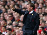 Liverpool Manager Brendan Rodgers gestures during the Barclays Premier League match between Liverpool and Tottenham Hotspur at Anfield on March 30, 2014