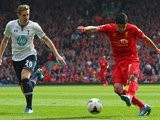 Liverpool's Luis Suarez scores against Tottenham Hotspur on March 30, 2014.