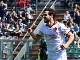 AS Roma's forward Mattia Destro celebrates after scoring during the ItalianSerie A football match Sassuolo vs AS Roma at 'Mapei Stadium' in Reggio Emilia on March 30, 2014