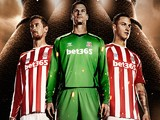 Peter Crouch, Asmir Begovic and Marco Arnautovic model the 2014/15 Stoke City home shirt, sponsored by Warrior Sports