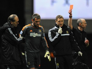 An injured Allan McGregor of Hull City is shown a red card by Referee Mike Dean during the Barclays Premier League match between West Ham United and Hull City at Boleyn Ground on March 26, 2014