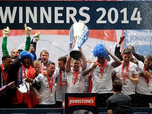 Peterborough captain Tommy Rowe lifts the trophy after his team won the Johnstone's Paint Trophy Final between Chesterfield and Peterborough United at Wembley Stadium on March 30, 2014