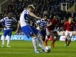 Pavel Pogrebnyak of Reading scores his team's first goal of the game during the Sky Bet Championship match between Reading and Barnsley at Madejski Stadium on March 25, 2014
