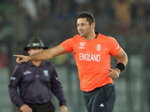 England bowler Tim Bresnan celebrates after taking the wicket of Indian batsman Shikhar Dhawan during the ICC World Twenty20 tournament's warm up cricket match between England and India at The Sher-e-Bangla National Cricket Stadium in Dhaka on March 19, 2