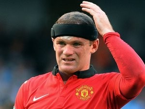 Wayne Rooney looks dejected against Manchester City on September 22, 2013.